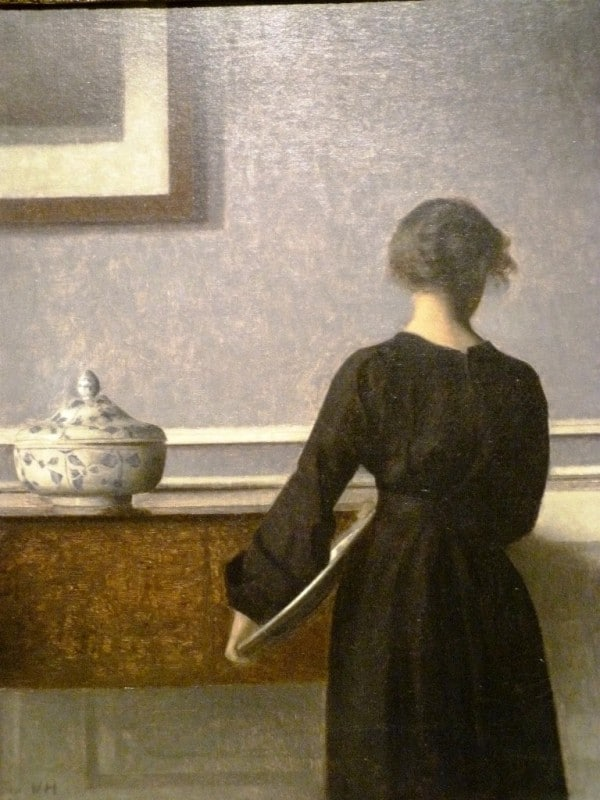vilhelm hammershoi, interior with young woman seen from behind